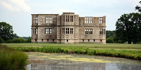 A panoramic vieew of Lyveden New Bield summer house and its surrounding parkland