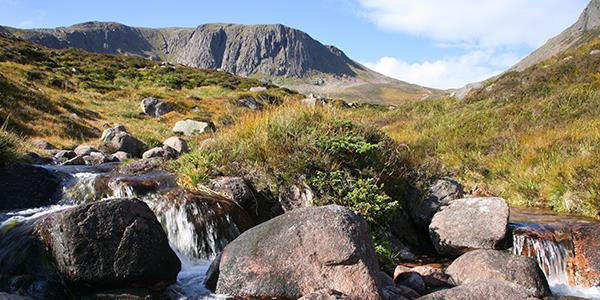 A stream flows through the spectacular scenery of Scotland's Cairngorm mountains