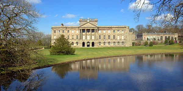 A panoramic view of Lyme Park stately home and surrounding parkland